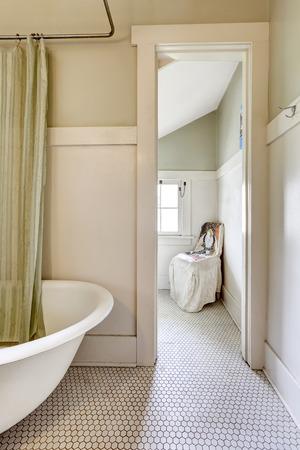 white trim: Bathroom in light green tone with white trim