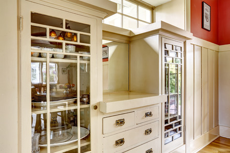 drawers: Built-in antique storage combination with glass doors and drawers Stock Photo
