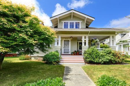 front porch: House exterior. Clapboard siding trim. View of entrance porch with flower pots