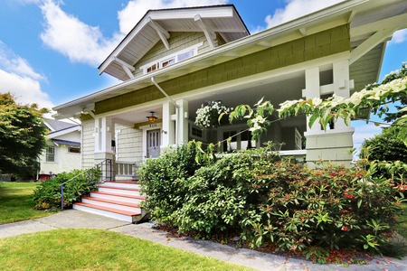front porch: House exterior. Clapboard siding trim. View of entrance porch with stairs Stock Photo