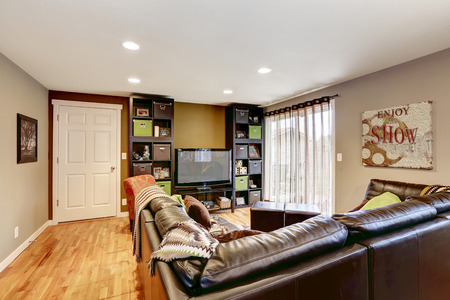 family couch: Cozy family room with leather couch and TV