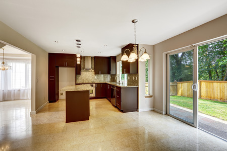 shiny floor: Modern kitchen room with matte brown cabinets, shiny granite tops. House interior with marbel tile floor and exit to backyard