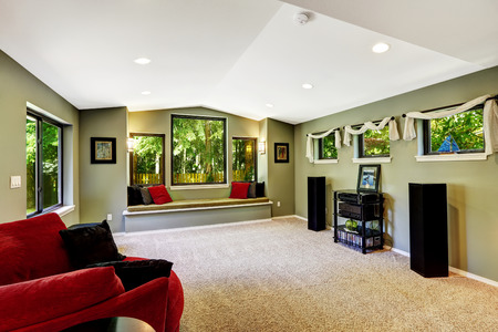 sitting area: Living room interior with comfort sitting area by the window.  Room decorated with red and black pillows