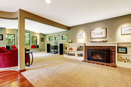 Living Room In Light Green Color With Brown Soft Carpet Floor Fireplace Derocated White