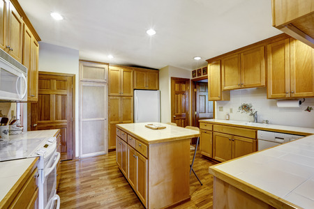 kitchen island: Kitchen room with wooden storage combination and kitchen island