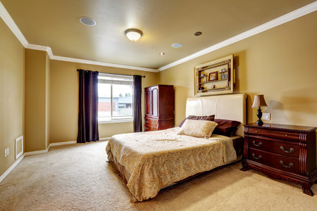 master bedroom: Spacious master bedroom interior with carved wood furniture set