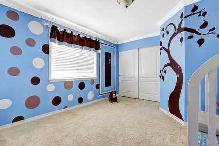 murals: Beautiful baby room interior with cheerful murals on bright blue walls