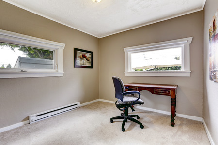 designer chair: Light grey office room with two windows. Furnished with wooden desk and whirlpool chair