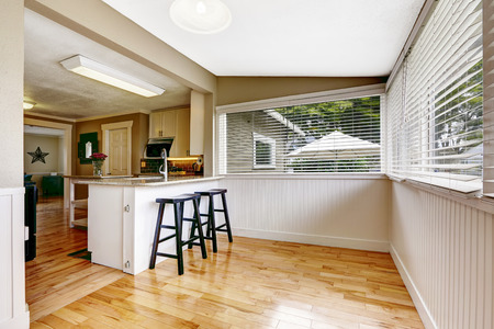 white trim: Empty dining area with white plank trim in kitchen room
