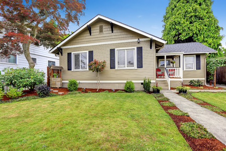 american house: American house exterior with curb appeal. Walkout deck with white railing and stairs Stock Photo