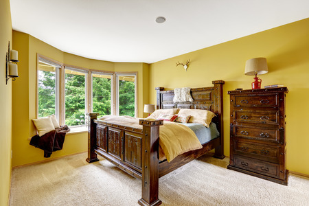 furniture design: Farm house interior. Luxury bedroom interior. Beautiful wooden high bed with large dresser