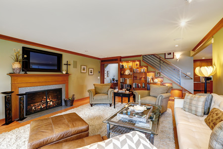 design: Family room with comfort sitting area, fireplace and TV in american house Stock Photo