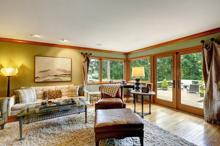 Family room with comfort sitting area on soft rug. Room has walkout deck photo