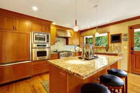 Beautiful kitchen storage combination with granite tops adn modern steel stainless appliances