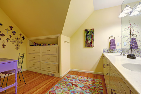 drawers: Kids bathroom interior with vaulted ceiling. Bathroom vanity cabinet with mirror., built-in cabinet with drawers and table