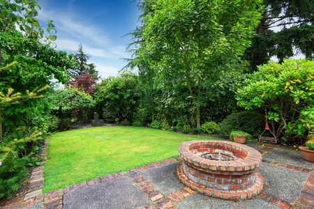 fire brick: Backyard landscape. patio area with brick fire pit