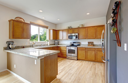 stainless steel kitchen: Spacious kitchen room with granite tops, steel stainless appliances and new hardwood floor