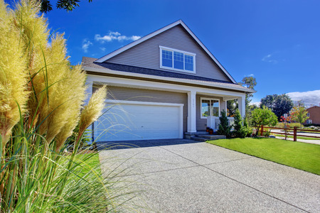 garage on house: House exterior with garage and driveway. Beautiful front yard landscape during summer in Washington state Stock Photo