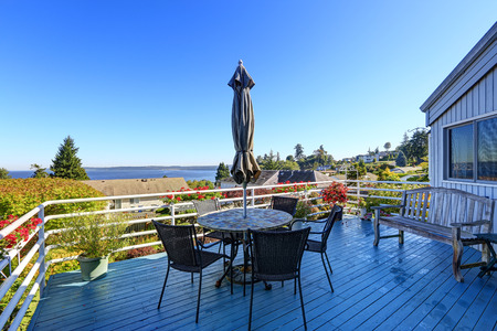 Walkout deck with patio area overlooking scenic bay view in Federal Way, WA during summer time