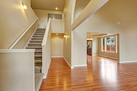 remodeled: Empty house with hardwood floor, high ceiling and light ivory walls