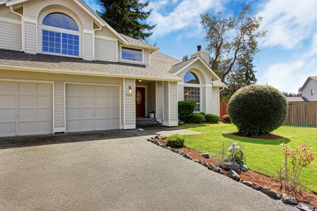 front: Luxury house exterior with tile roof. House with garage and front yard landscape