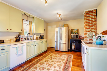 rug: Kitchen room interior in old house with brick and light mint storage combination