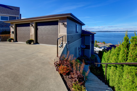 two car garage: House exterior. Two car garage with driveway. Puget Sound view, Tacoma, WA Stock Photo
