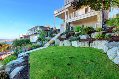 tacoma: Leveled landscape design with rocks and flowers, bushes and trees. Real estate in Tacoma, WA
