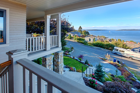 tacoma: House with wraparound walkout deck. View of puget sound and driveway, Tacoma, WA
