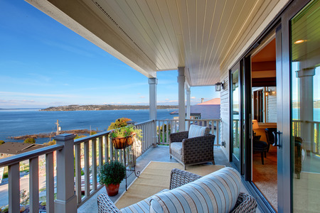 Cozy walkout deck with chairs with scenic view on Puget Sound, Tacoma, WA photo