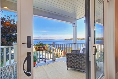 puget: Cozy walkout deck with chairs with scenic view on Puget Sound, Tacoma, WA Stock Photo