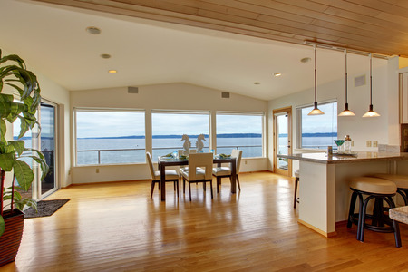 bay area: Luxury house interior. Bright elegant dining area with glass wall and  scenic bay view