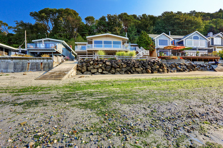 american house: Luxury houses with exit to private beach. Rock wall with dock