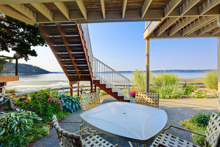 Backyard patio area with table and chairs and scenic Puget Sound view, Burien, WA photo