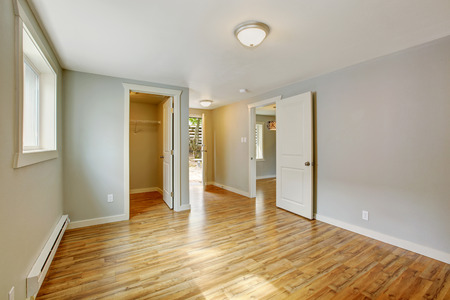 walk in closet: Empty house interior. Bedroom with walk in closet and exit to backyard area Stock Photo