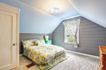 vaulted ceiling: Light grey bedroom interior with vaulted ceiling and plank paneled walls