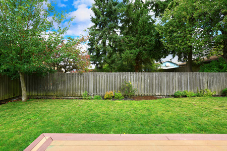 on the fence: Countryside house backyard with old wooden fence.