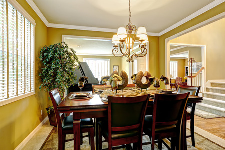 dining table and chairs: Luxury house interior. Served dining table with chairs and decorative tree in the corner
