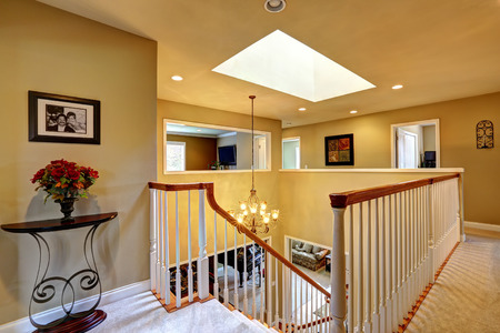 upstairs: Luxury house interior. Upstairs hallway with staircase  and skyline