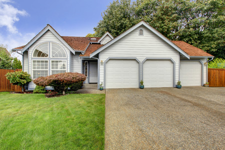 cladding tile: House exterior with orange tile roof, large arch window and three car garage