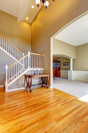 foyer: Luxury house interior. Foyer with staircase and high ceiling