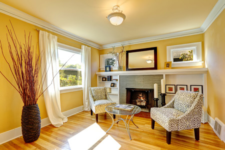sitting area: Family room with cozy sitting area. Two chairs and glass top coffe table. Room decorated with dry bushes