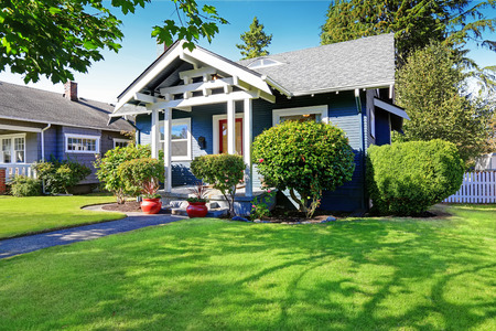 curb appeal: Simple house exterior with tile roof. Front porch with curb appeal