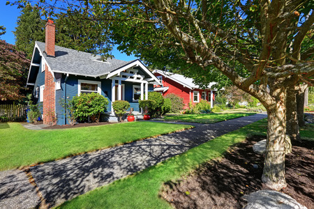 Simple house exterior with tile roof. Front yard landscape and walkway Stock Photo