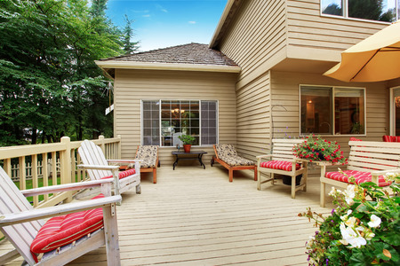 Wooden walkout deck with many deck chairs