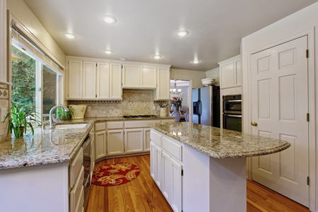 white trim: Kitchen room with white storage combination, granite tops and kitchen island
