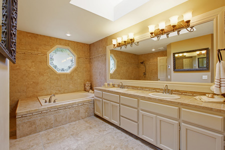 Luxury bathroom interior with tile trim and big vanity cabinet with two sinks and large mirror Stock Photo