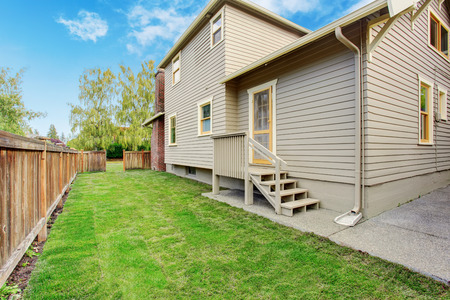 House with small deck and fenced backyard Stock Photo