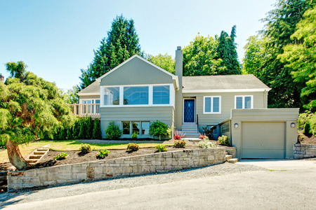 garage on house: House exterior in clapboard siding. House with garage, driveway and front yard landscape