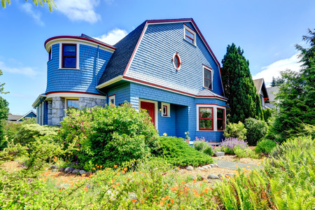 trim wall: Clapboard siding house in blue color with red trim and stone wall trim